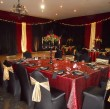 function-in-black-red-and-gold-in-village-hall